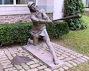 Bronze sculpture commemorating the AAGPBL, at the National Baseball Hall of Fame. Photo by Eric Enfermero